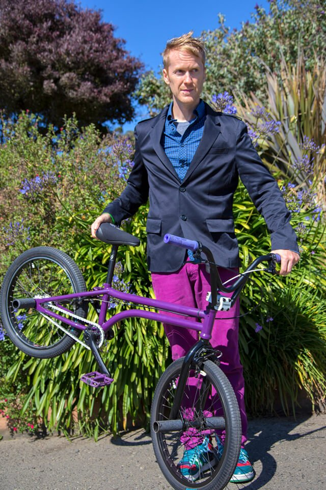 Timothy Radley lifts the back wheel of his BMX bicycle
