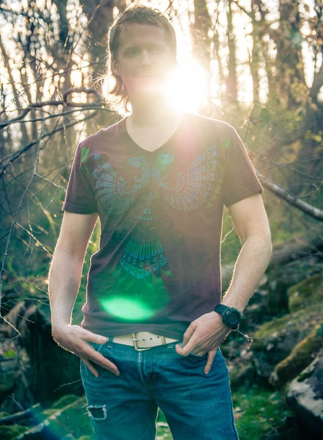 Timothy Radley poses outside with the sun in view
