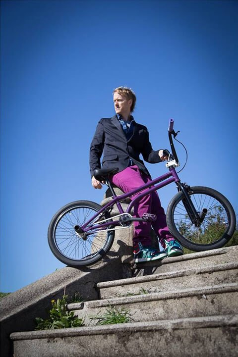 Timothy Radley stands beside his BMX bicycle in San Francisco