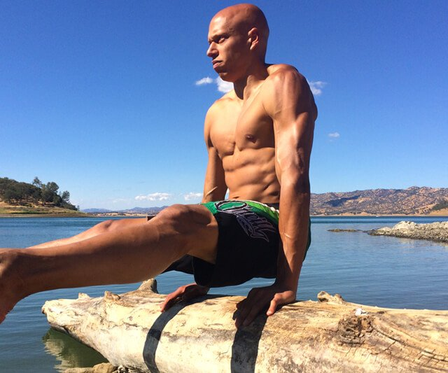 Cyrus Khambatta exercises outdoors by water