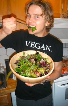 Evan Rock eats a salad in a kitchen