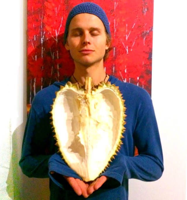 Evan Rock holds a heart-shaped durian shell