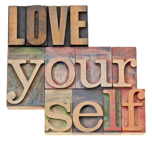 """The words """"Love Yourself"""" in wood type"""
