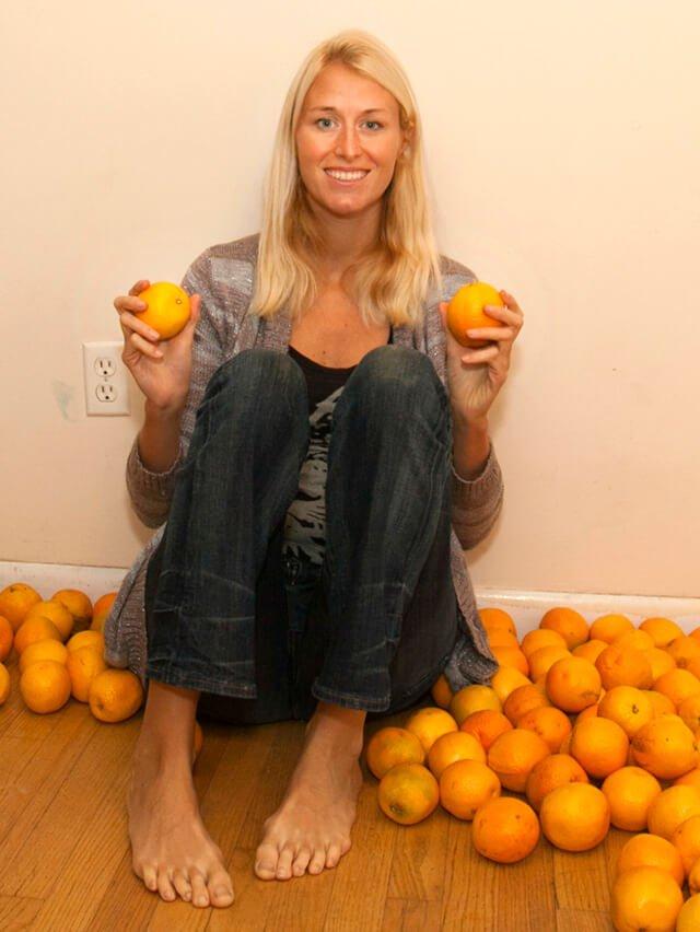 Natalie Lenka holds oranges while sitting