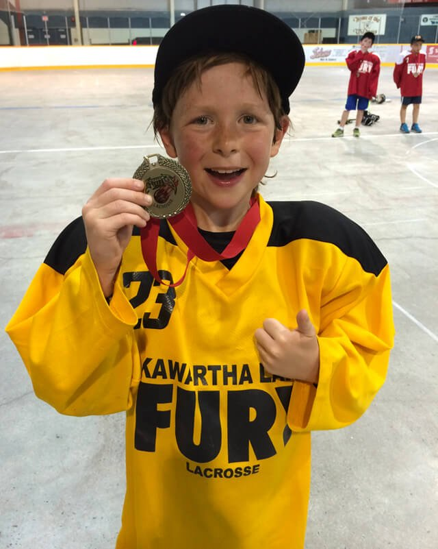 Raw Food Levi holds his medal for a lacrosse championship