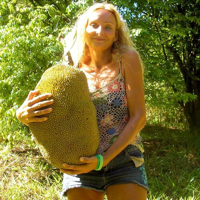 Anne Osborne holds a large jackfruit she foraged in February 2014