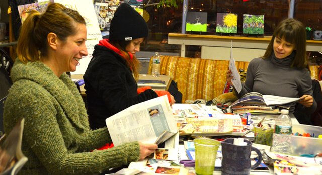 Faith Egans, Kristen Hildebrand and Kimberly Monks work on creating their vision boards