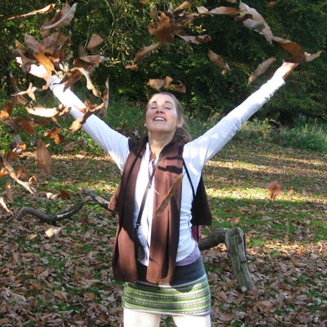 Reny Kattel joyously plays with fallen tree leaves