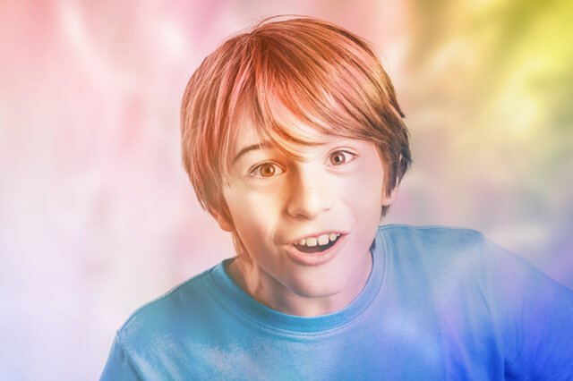 Boy lost in a colorful dreamworld
