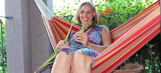 Anthea Frances Falkner relaxes on a hammock on a patio