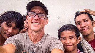 Mark Tassi photographs himself and others in Cambodia
