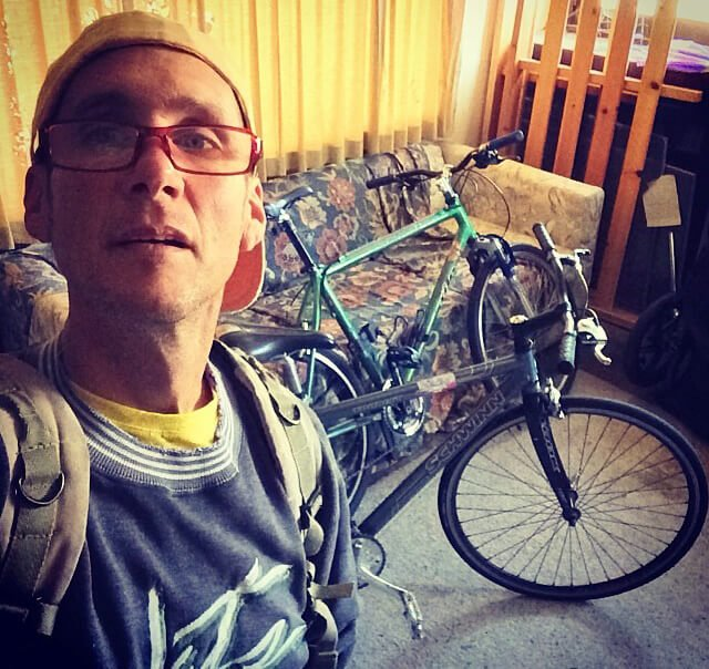 Mark Tassi photographs himself with bicycles