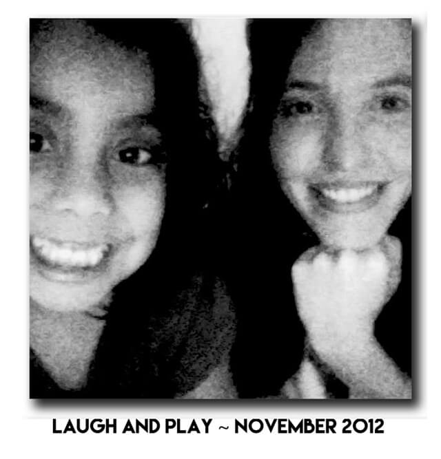 Jenny Lapan laughs and plays with a girl