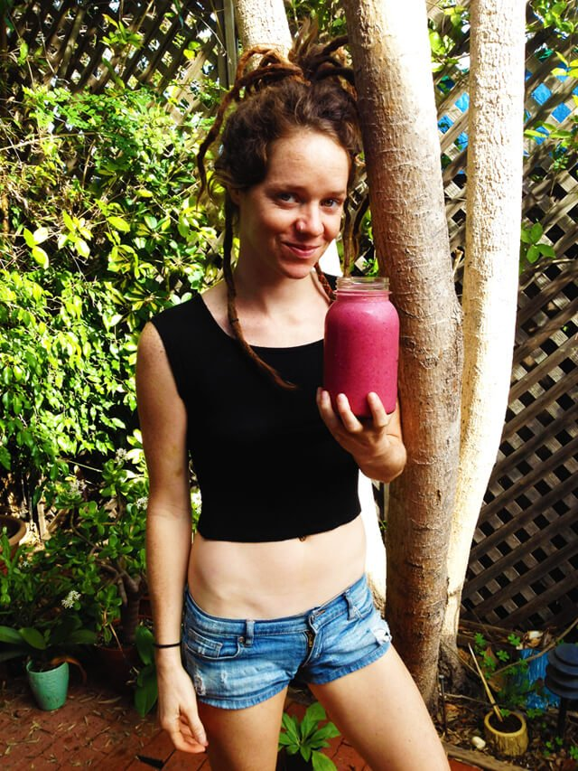 Brittany Taylor holds a dark-red smoothie in Santa Barbara