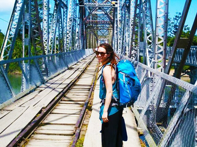 Brittany Taylor walks on a bridge