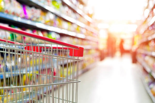A shopping cart is being navigated in a grocery store