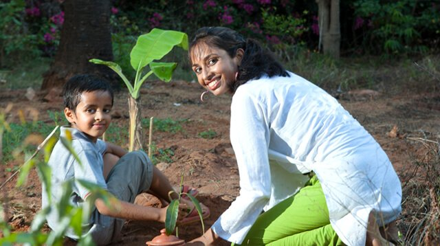 Anjali and Manikya Sanghi plant fruit trees