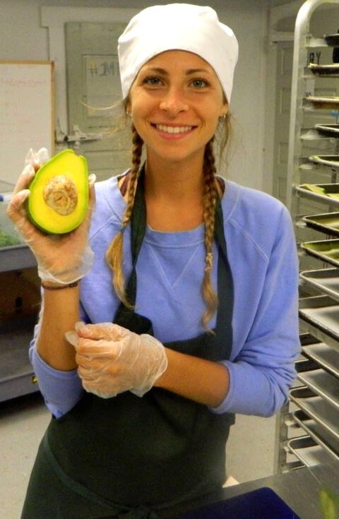 Kat Green holds an avocado