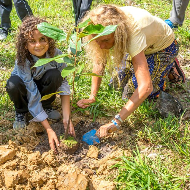 Anne and Cappi Osborne plant a durian tree at Eco Ponies Garden in Brunei