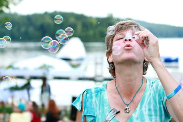 Itsy Sweeney blows bubbles at the 2014 Woodstock Fruit Festival