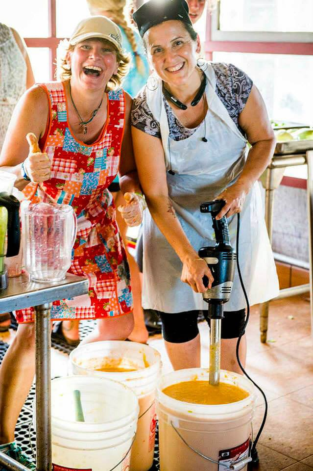 Itsy Sweeney and Alicia Ojeda prepare food at the 2015 Woodstock Fruit Festival in Hawaii
