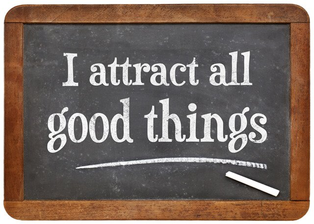 """I attract all good things"" written in chalk"