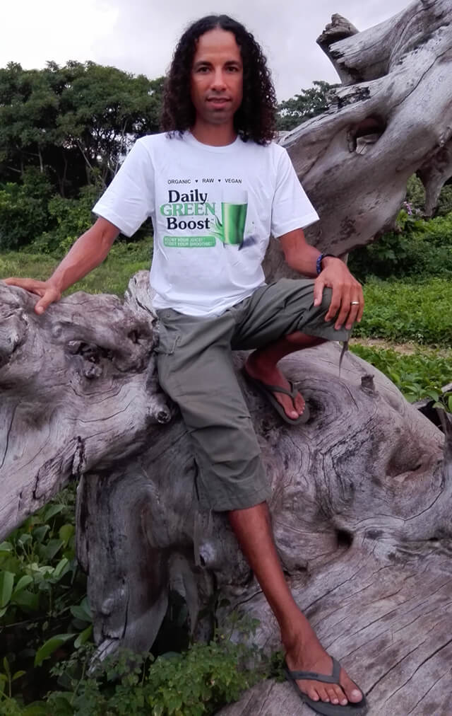 Jamie Pounds wears a Daily Green Boost T-shirt