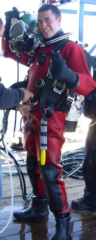 Jon Kozak smiles while suited up in diver gear