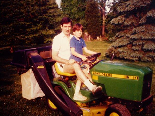 Korey Constable with his father a garden tractor