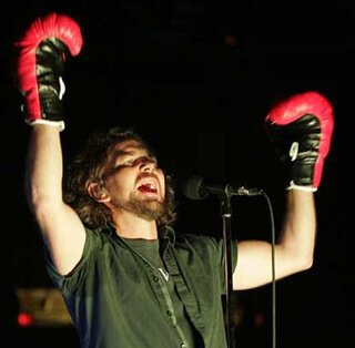 """Pearl Jam's Eddie Vedder wears """"Rocky"""" boxing gloves to kick off the final show at the Spectrum in Philadelphia in 2009."""